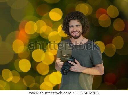Photographe caméra mains vert jaune rouge Photo stock © wavebreak_media