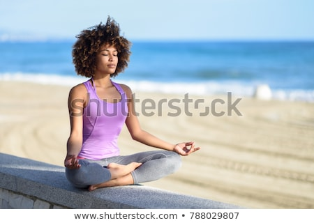 Happy Woman Meditating With Eyes Closed Stock photo © AndreyPopov