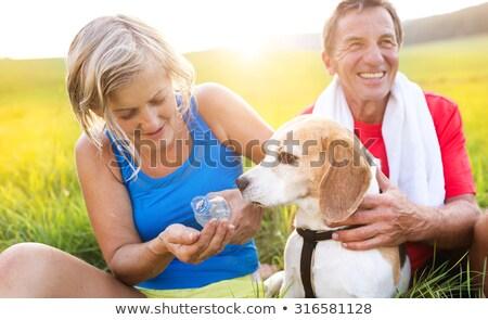 Sport couple drinking water having break from running Stock photo © Kzenon