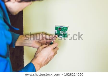Villanyszerelő installál elektomos termosztát új ház víz Stock fotó © galitskaya