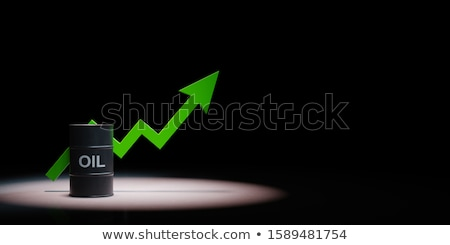 Oil Barrel With Rising Arrow Chart Spotlighted on Black Background Stock photo © make