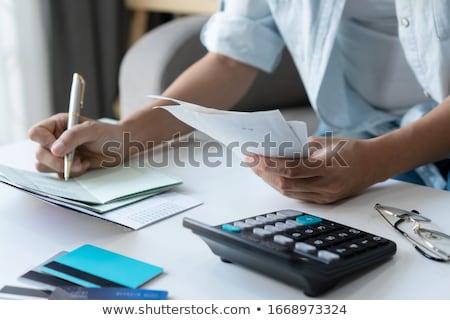Zakenvrouw hand Bill calculator Stockfoto © AndreyPopov