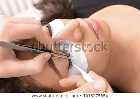 Young woman getting eyelash extension Stock photo © Elnur