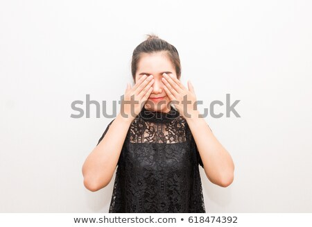 Image of beautiful asian girl smiling and covering her eyes with Stock photo © deandrobot