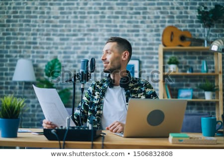 blogger with laptop and microphone audio blogging Stock photo © dolgachov