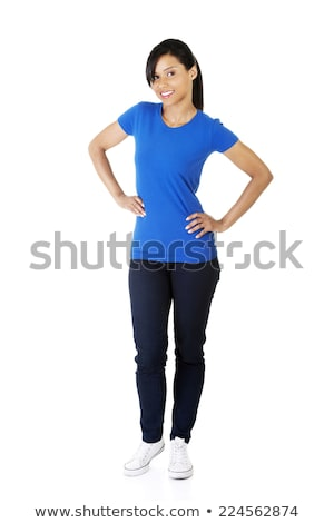 Attractive young woman in a blue jeans stock photo © filipw