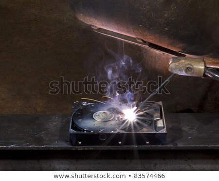 repairing a defect hard disk with welding apparatus Stock photo © gewoldi