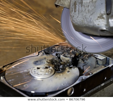 working with angular grinder on open hard drive stock photo © gewoldi