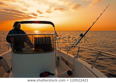 boat sunset scene Stock photo © smithore