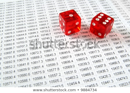 two red dice on a spreadsheet financial data print out stock photo © latent