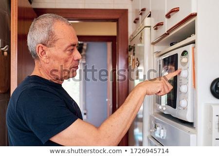 человека микроволновая печь дома волос домой пить Сток-фото © photography33