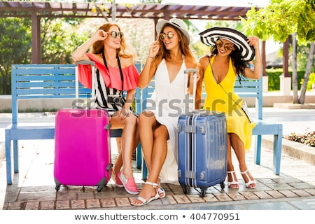 brunette with suitcase sitting stock photo © zastavkin