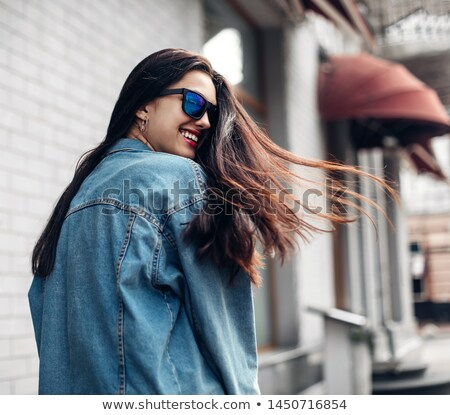 brunette in jeans jacket Stock photo © yurok
