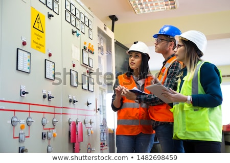 Stockfoto: Female Electrician At Work