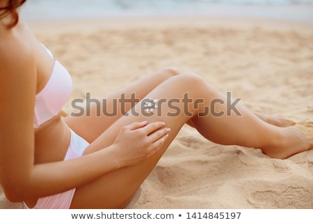 Stock photo: sexy female bikini beach body with  suncream