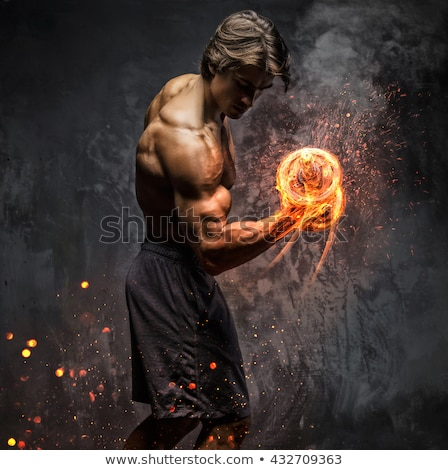 Portrait of a determined man lifting a dumbbell Stock photo © photography33