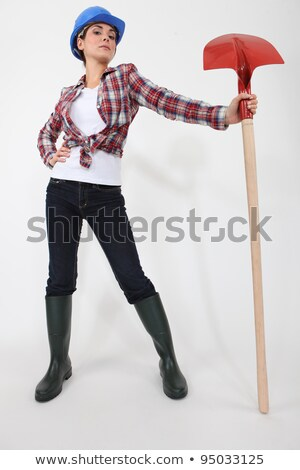 woman proudly holding spade stock photo © photography33