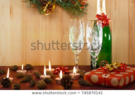 lying champagne bottle and two glasses stock photo © karandaev