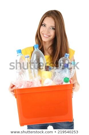 Girl sorting plastic bottles for garbage Stock photo © photography33