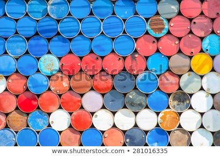 heap of blue metal oil barrels stock photo © tashatuvango