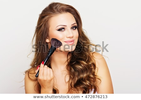 Woman using a blusher brush Stock photo © photography33