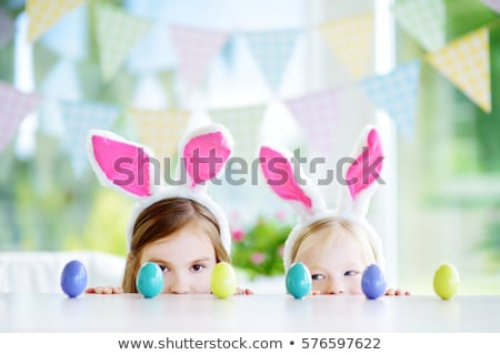 two happy kids with easter bunny and eggs happy easter stock photo © len44ik