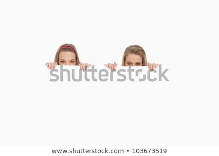 szőke · nő · rejtőzködik · mögött · poszter · tart · női - stock fotó © wavebreak_media