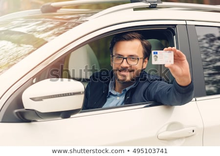 young man showing his driving license Stock photo © photography33