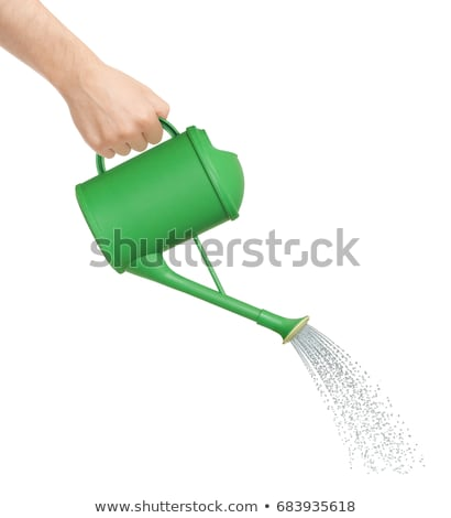 hand pouring water from watering can stock photo © elenaphoto