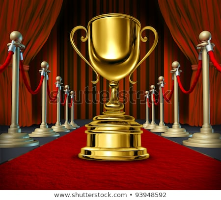 Golden Cup On a red Carpet with velvet Curtains Stock photo © Lightsource