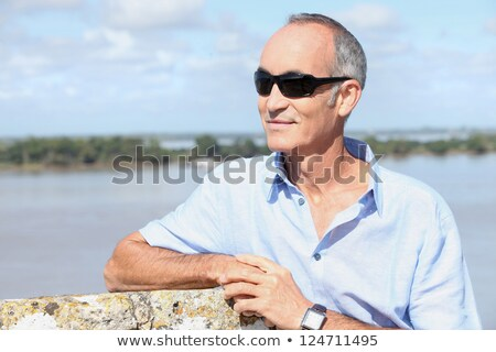 Grey-haired man stood by river-front Stock photo © photography33