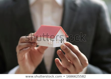 businessman holding a model stock photo © photography33