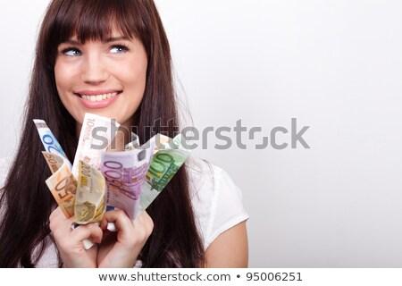 beautiful success businesswoman holding euro notes stock photo © lunamarina