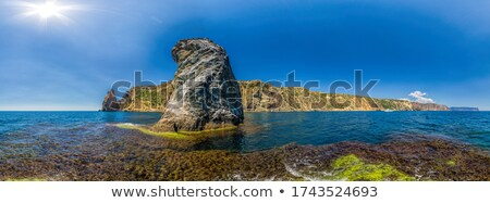 Sea cave on rocky coastline Stock photo © speedfighter