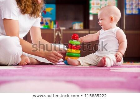 Baby spelen voet verscheidene maanden oude Stockfoto © icefront