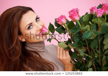 Gyönyörű nő nagy virágcsokor virágok karok illatos Stock fotó © hasloo