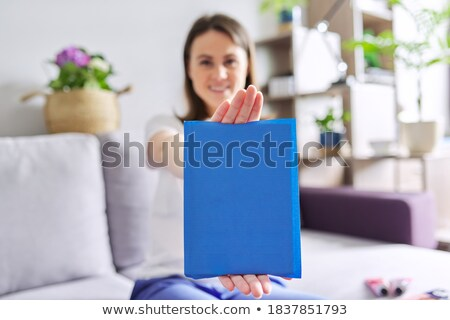 Businesswoman showing book of success. Business as concept. Copy Stock photo © hasloo