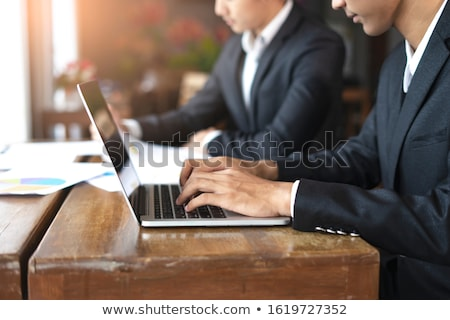 businessman typing computer keyboard with pie chart and other in stock photo © stevanovicigor