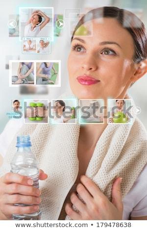 Stockfoto: Sporty Woman Working Out Using Modern Virtual Interface