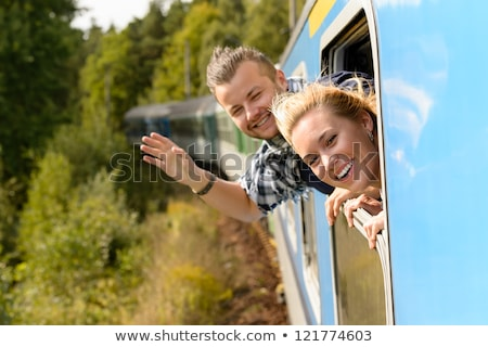 Couple with heads out the train window Stock photo © CandyboxPhoto
