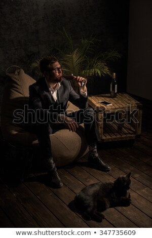 Foto stock: Businessman Holding A Glass Of Red Wine