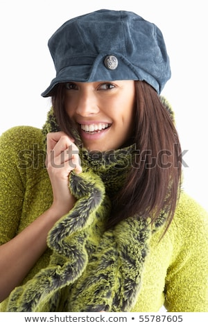 Fashionable Young WomanWearing Cap And Knitwear In Studio Stock photo © monkey_business