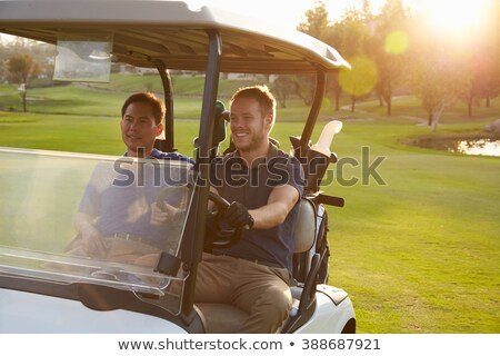 Two Male Golfers Riding In Golf Buggy On Golf Course Stock photo © monkey_business