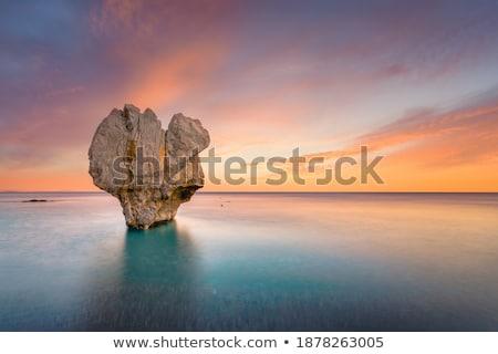 áspero beira-mar rochas Grécia turquesa mar Foto stock © Mps197