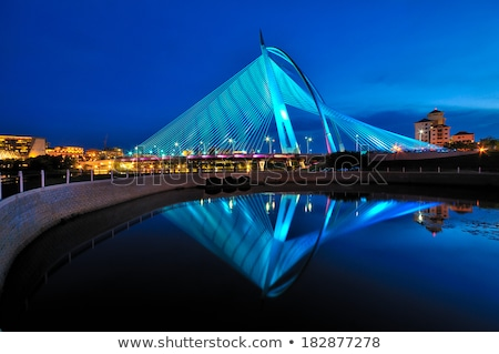 Highlighted bridge at night and reflected in the water Stock photo © filipw