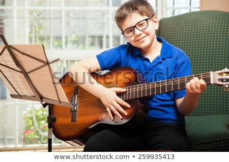 Młodzik nauki grać gitara parku dzieci Zdjęcia stock © OleksandrO