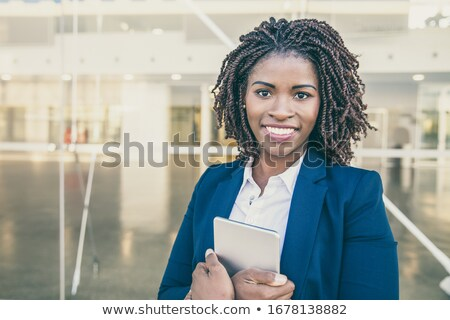 corporate woman holding tablet outside office stock photo © dash