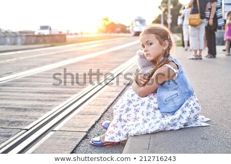 lonely girl on a city tram station stock photo © kor