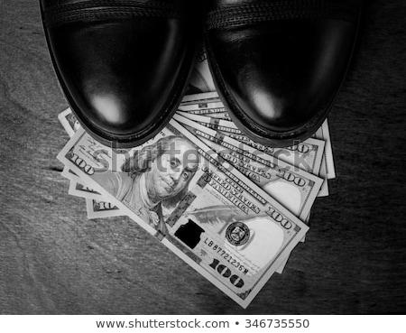 negro · zapato · dinero · blanco · piel · mujeres - foto stock © klinker