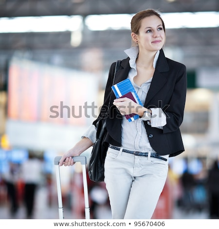 Stock photo: Young female passenger at the airport, about to check-in